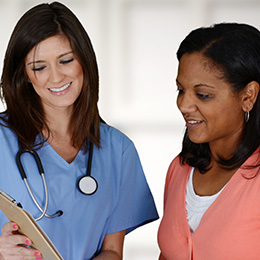 female nurse speaking with Hispanic patient